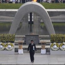 epa05457793 Japanese Prime Minister Shinzo Abe leaves a cenotaph after delivering his speech during the peace memorial ceremony marking the 71st anniversary of the nuclear bombing of the city at Hiroshima Peace Memorial Park in Hiroshima, western Japan, 06 August 2016. Hiroshima marked the 71st anniversary of the world's first nuclear bombing of the city on 06 August.  EPA/KIYOSHI OTA