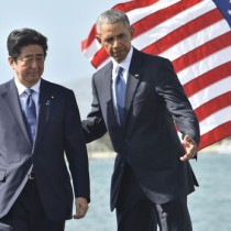 """US President Barack Obama (L) speaks with Japanese Prime Minister Shinzo Abe  after they spoke on Kilo pier near the USS Arizona Memorial December 27, 2016 at Pearl Harbor in Honolulu, Hawaii.  Abe and Obama made a joint pilgrimage to the site of the Pearl Harbor attack on Tuesday to celebrate """"the power of reconciliation. """"The Japanese attack on an unsuspecting US fleet moored at Pearl Harbor turned the Pacific into a cauldron of conflict -- more than 2,400 were killed and a reluctant America was drawn into World War II. / AFP PHOTO / Nicholas Kamm"""